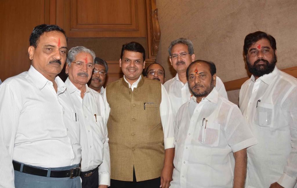 Mumbai: Maharashtra Chief Minister Devendra Fadnavis during a press conference with Shiv Sena leaders Subhas Desai and Divakar Ravate in Mumbai, on Dec 4, 2014. (Photo: Sandeep Mahankal/IANS)